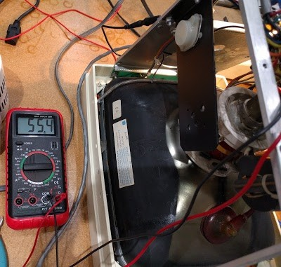 Testing the 55V power supply in the Xerox Alto's monitor.