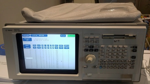 The vintage Agilent 1670G logic analyzer that we connected to the Xerox Alto. The screen shows the start of the boot sequence.