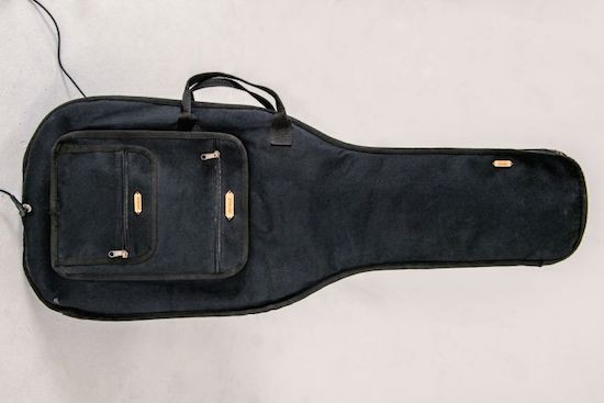 Play the guitar on a guitar bag