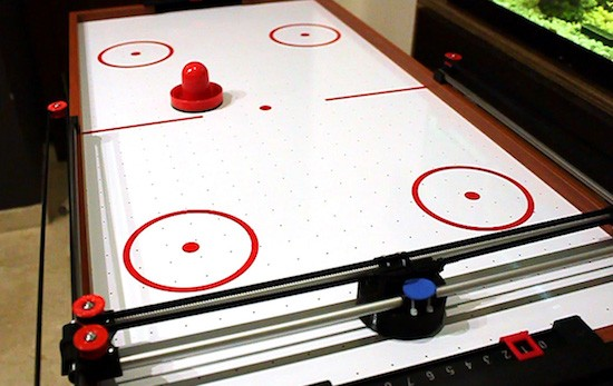 This phone-controlled robot can beat you in air hockey