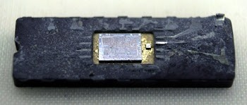 Inside the package of the 8008 microprocessor, the silicon die is visible.