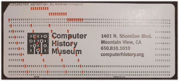 An IBM punched card, showing the encoding of digits and letters.