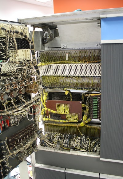 Opening the console panel (left) of the IBM 1401 mainframe shows the 4K core memory unit (center).