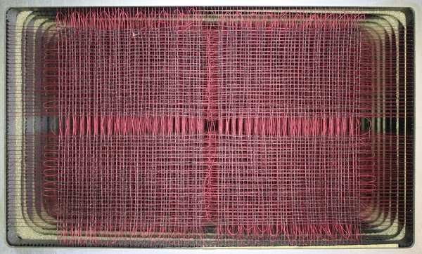 Core memory in the IBM 1401. Each plane of cores has 4000 cores in a 80x50 grid.